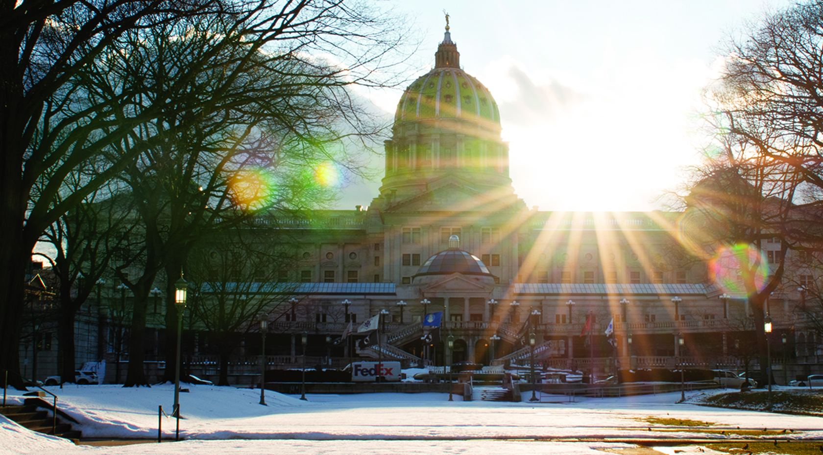 The Pennsylvania State Capitol at sunset from Soldier's Grove.